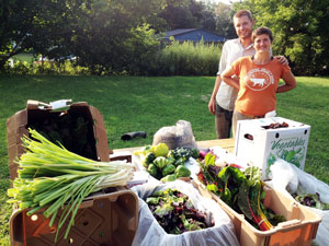 Rachel Davis and Brian Hedden providing fresh, organic produce to the Philmont Food Pantry