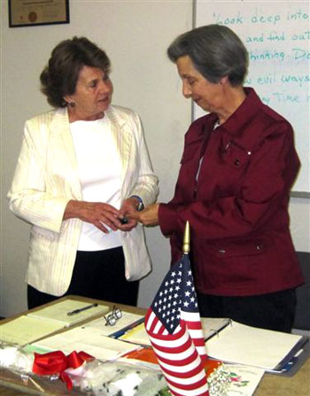 President's Pin presented to Patricia Sama